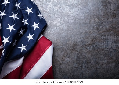 An Overhead View Of American Flag On Dark Concrete Background - Shutterstock ID 1389187892