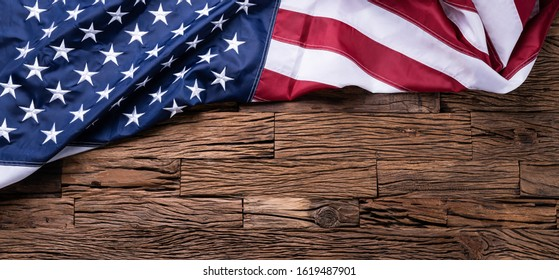 An Overhead View Of American Flag On Wooden Background