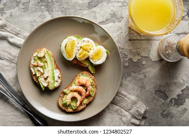 Overhead view of avocado toasts. Plant-based food