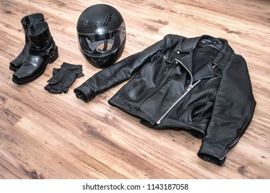 Overhead view of biker accessories Items included motorcycle helmet, gloves, boots and jacket. Motorcycle travel dream concept, Outfit of Biker and accessories with copy space, Ready to ride