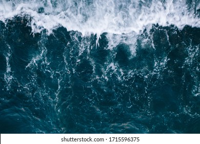 Overhead view to blue stormy ocean waves with white foam. - Shutterstock ID 1715596375