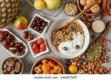 Overhead view of bowl with granola and berries. Different types of berries and nuts. Stock image.