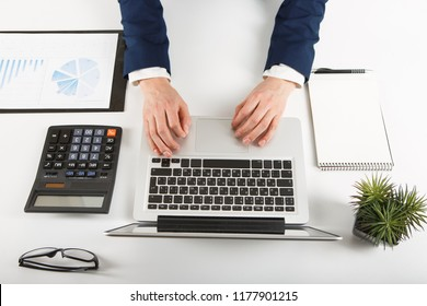 Overhead view of businessman working at computer in office