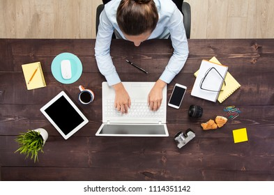 Overhead View Of Businesswoman Working At Computer In Office