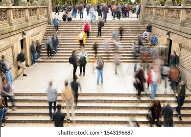 Overhead view of busy crowds of people walking up and down the steps at Bethesda Terrace in Central Park, New York City NYC