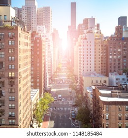 Overhead view of a busy street scene on 1st Avenue in Manhattan New York City with sunlight background