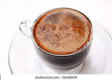 Overhead view of coffee with foam, close up, macro, in glass cup, Coffee background, Coffee foam texture