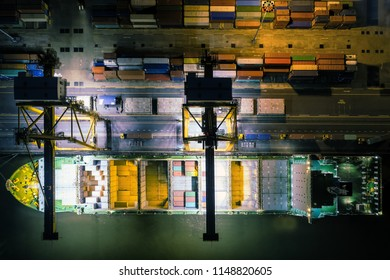 Overhead view of containers being loaded onto a large ship..