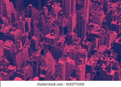 Overhead view of crowded buildings in Manhattan New York City in pink and blue