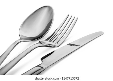 An overhead view of a cutlery set in a white background