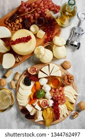 Overhead view of Different types of cheese and snacks