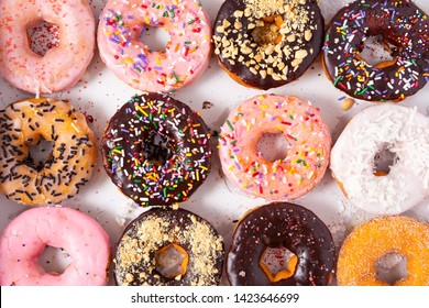 Overhead view of a dozen freshly baked doughnuts