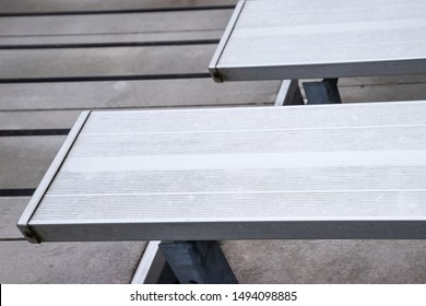 Overhead view of empty metal bleachers seats in football, soccer or baseball stadium during local game