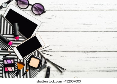 Overhead view of essential beauty items, Top view of cosmetics and female accessories