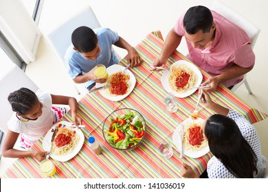 Overhead View Of Family Eating Meal Together
