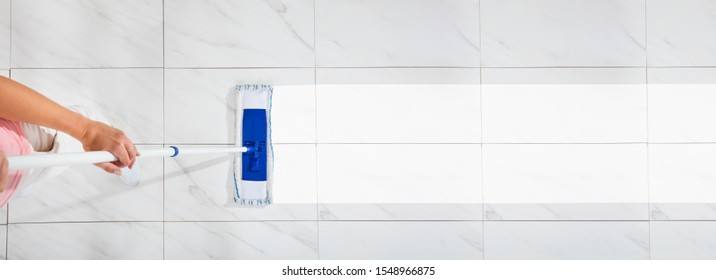 An Overhead View Of A Female Cleaning The White Floor With Wet Mop