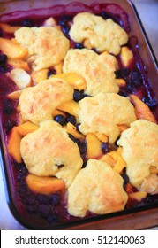 Overhead view of fresh peach and blueberry cobbler