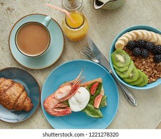 Overhead view of freshly delicious healthy breakfast served on wooden table. Healthy food