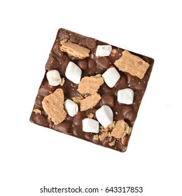 Overhead view of a gourmet smores bar on a white background