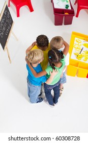 overhead view of group of preschool kids hugging