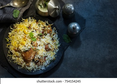 Overhead view of Homemade Chicken Biryani on dark moody background