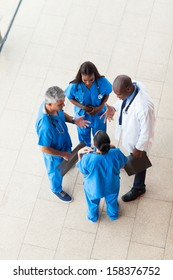 overhead view of medical workers having a meeting at hospital
