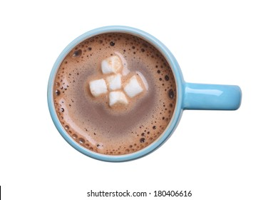 Overhead view of a mug of hot cocoa with marshmallows cutout, isolated on white background