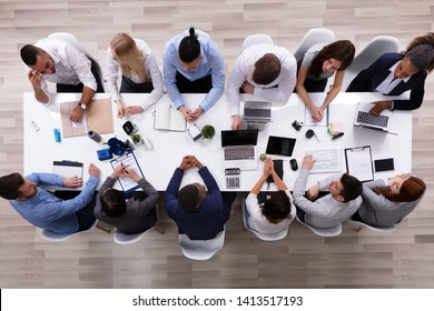 Overhead View Of A Multiracial Business People Sitting Together Having Discussion In The In Meeting