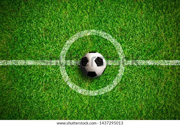 Overhead view on isolated soccer ball in field with white markings on grass. Dark vignette at edges.