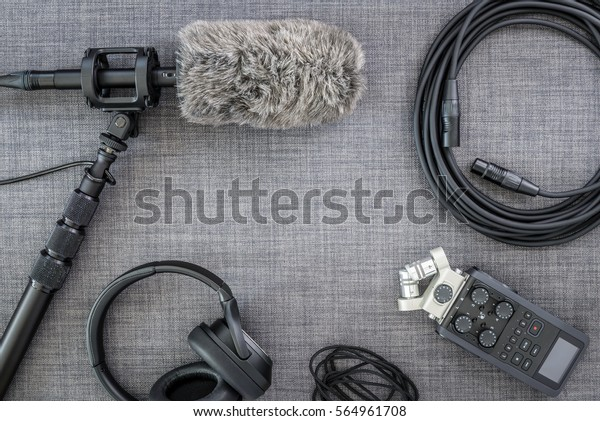 Overhead view of professional digital audio recording gear and microphone.