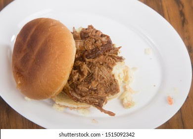 Overhead view of Pulled Pork Barbecue Sandwich with Coleslaw and Sauce
