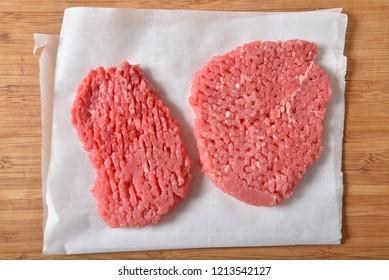 Overhead view of raw cube steaks on wax paper