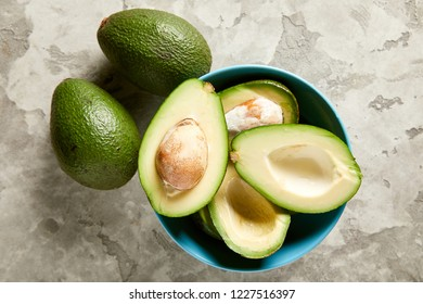 Overhead view of sliced avocado in bowl. Raw avocado. Healthy food