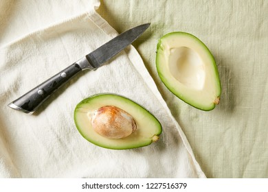 Overhead view of sliced avocado on napkins. Raw avocado. Healthy food