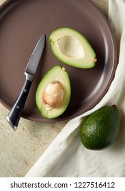 Overhead view of sliced avocado in plate. Raw avocado. Healthy food