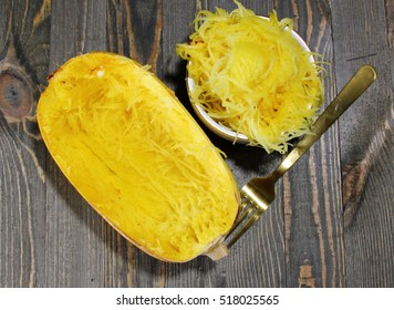 Overhead view of Spaghetti squash on a wooden background