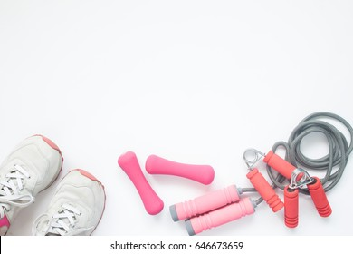 Overhead view of sport bra and sport equipments in pink color, healthy lifestyle concept with copy space