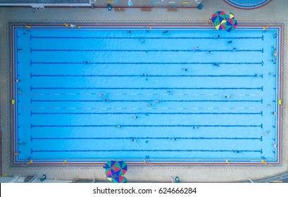 Overhead view of a swimming pool full of people