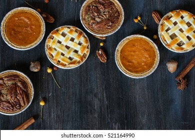 Overhead view of three mini  pies - apple pumpkin  and pecan pies  / Thanksgiving Desserts