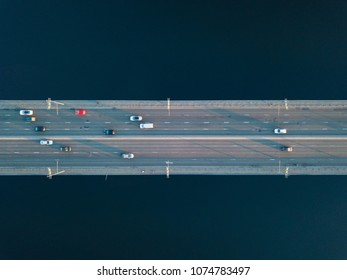 Overhead view of traffic with cars, taxis, bus on a North Bridge in Kyiv city