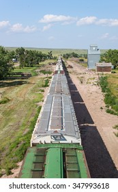 Overhead view of train and grain elevator