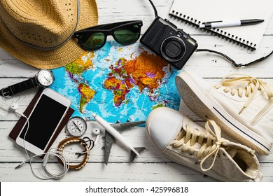 Photo of Overhead view of Traveler's accessories, Essential vacation items, Travel concept background