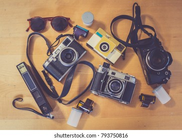 Overhead view of Traveler's accessories, Flat lay photography of Travel concept, old vintage cameras and film hipster style