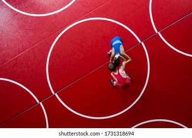 Overhead view of two wrestlers in the neutral position