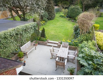 Overhead view of a typical suburban garden with patio furniture in Pinner, London, UK