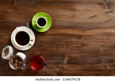 Overhead view of various sorts of tea and coffee. Flavoured with Assorted Herbs and coffee beans on a rustic wood board. Copyspace