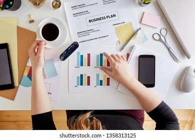Overhead view of woman planning business strategy. Desk of a modern businesswoman