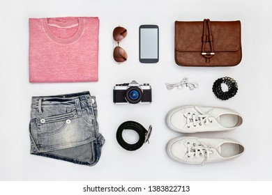 Overhead view of woman's outfit and accessories