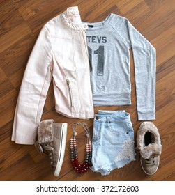 Overhead view of women's/girl's fashion with accessories. A hip outfit for girls.