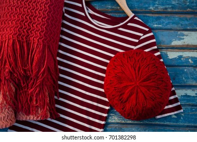 Overhead view of womenswear on wooden table